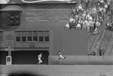 Polo Grounds, Manhattan, NY, May 19, 1956 – Hank Aaron chases down a Willie Mays triple