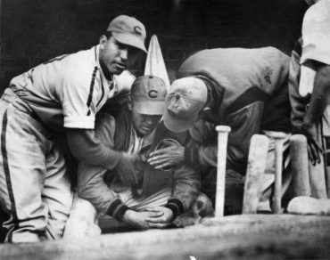 Wrigley Field, Chicago, IL, September 27, 1938 – Cubs Dizzy Dean is comforted after being pulled from crucial pennant race game