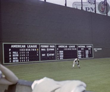 Fenway Park, Boston, MA, July 4, 1947 – Red Sox great Ted Williams in left field with the freshly painted Green Monster behind him
