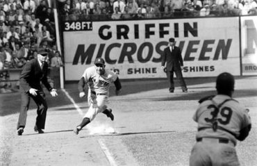 Ebbets Field, Brooklyn, NY, October 1, 1955 – Yogi Berra scores during Game 5 of the World Series