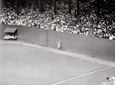 Polo Grounds, Manhattan, NY, June 28, 1951 – Giants Don Mueller snags a hard hit liner by Dodgers Carl Furillo at the top of the right field wall