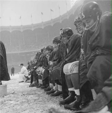 NFL in Ballpark Series, Yankee Stadium, Bronx, NY, December 14, 1958 – Giants try to stay warm during crucial game against the Cleveland Browns