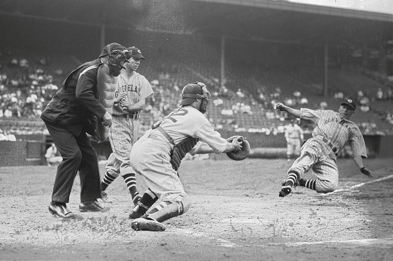 Fenway Park, Boston, MA, August 4, 1937 – Indians Frankie Pytlak  slides under the tag by Red Sox catcher/spy Moe Berg