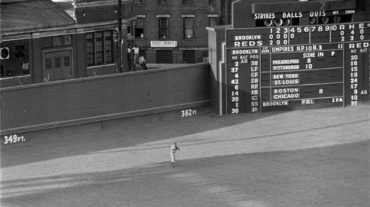 Crosley Field, Cincinnati, Ohio, July 20, 1950 – Dodgers' Jim Russell playing in the shadows of a iconic scoreboard during a Thursday doubleheader