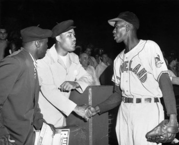 Joe Louis and Satchel Paige meet at Comiskey Park on August 13, 1948.