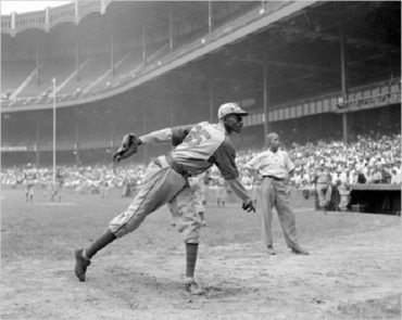 Yankee Stadium, Bronx, NY, August 2, 1942 – Satchel Paige Warms Up Before Monarchs Game