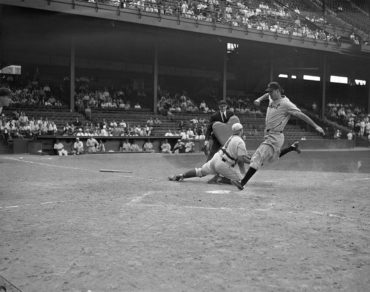 Shibe Park, Philadelphia, PA, June 4, 1940 – Detroit Tigers Hank Greenberg out at home in 8-6 loss to A's