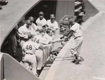 Polo Grounds, Manhattan, NY, May 29,1955 – Jackie Robinson is greeted by teammates after hitting home run