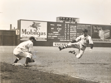 Navin Field, Detroit, MI, August 3, 1935 – Cleveland's Roy Hughes sliding into third base spikes up in a 5-4 extra-innings win over Tigers