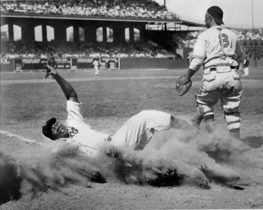 Comiskey Park, Chicago. IL, August 13, 1944 – The great Josh Gibson slides home during the 1944 Negro League All-Star game