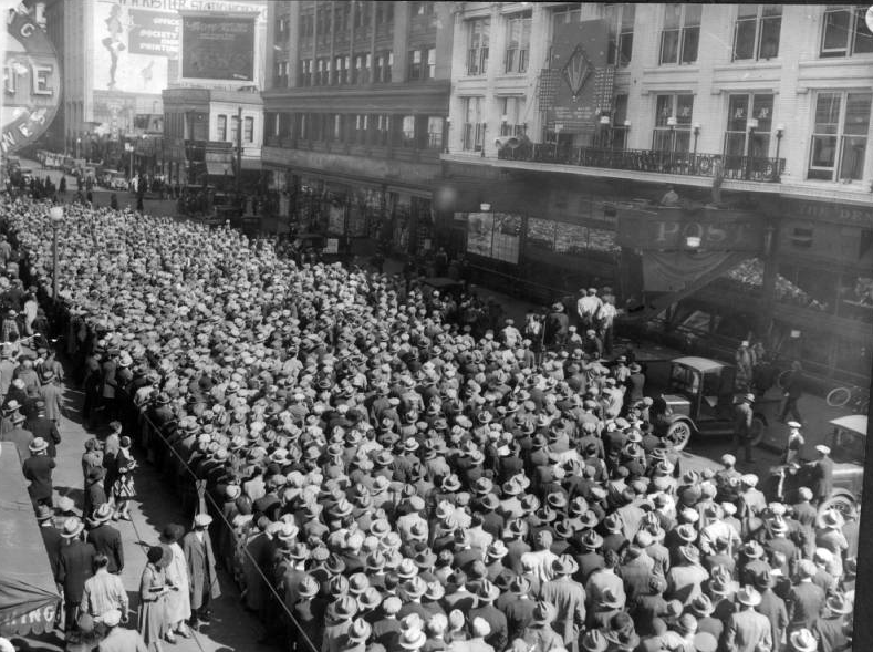 Denver, CO, October 5, 1927 – Big crowd follows Game 1 of 1927 World Series by animatronic scoreboard in front of Denver Post headquarters