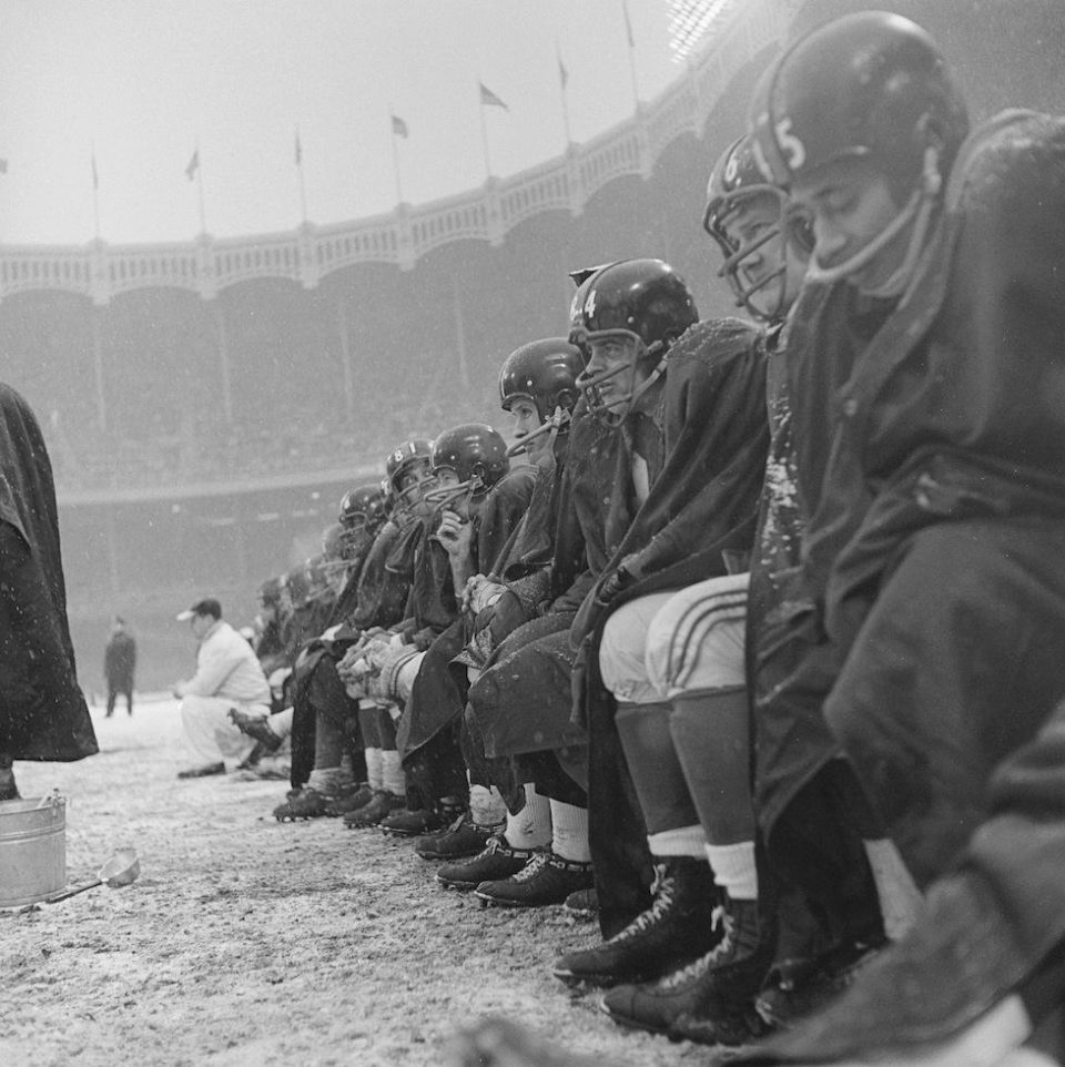 NFL in Ballpark Series: Yankee Stadium, Bronx, NY, December 14, 1958 – Browns and Giants battle each other and the elements for a playoff spot
